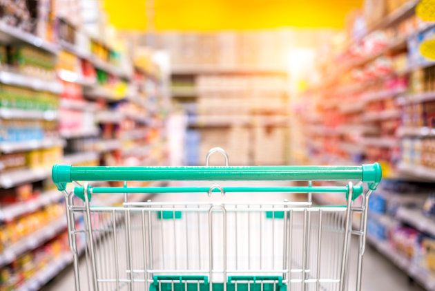Empty shopping cart in the supermarket shopping