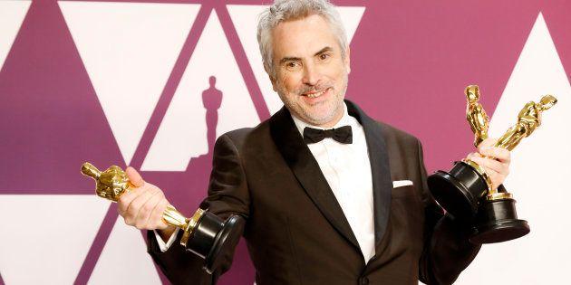 Alfonso Cuarón con sus tres