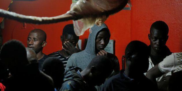 Un grupo de migrantes rescatados en el Estrecho de Gibraltar, esperando a desembarcar en el puerto de...