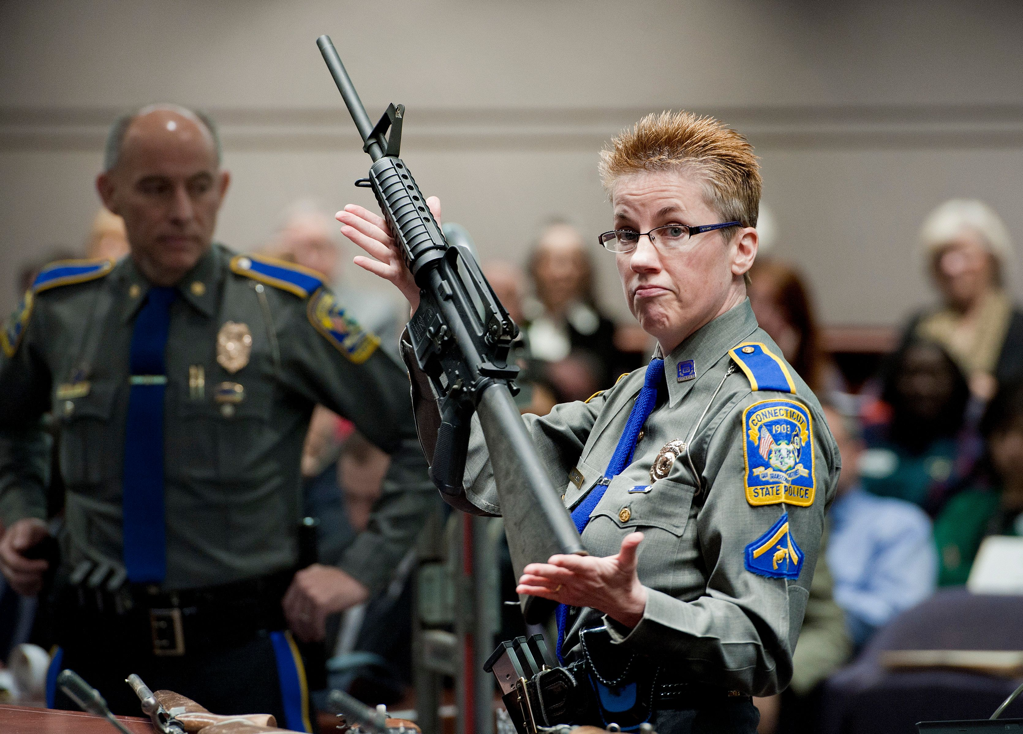 In this Jan. 28, 2013, file photo, firearms training unit Detective Barbara J. Mattson, of the Connecticut State Police, hold
