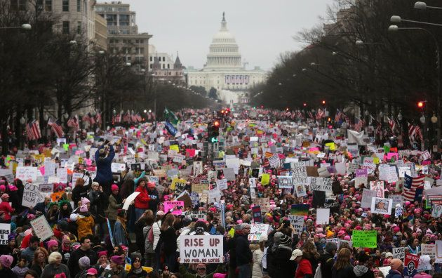 WASHINGTON, DC - JANUARY 21: Protesters walk during the Women's March on Washington, with the U.S. Capitol...