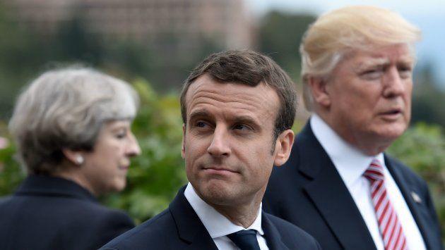 Emmanuel Macron, en primer término, con Theresa May y Donald Trump al fondo, en una imagen de