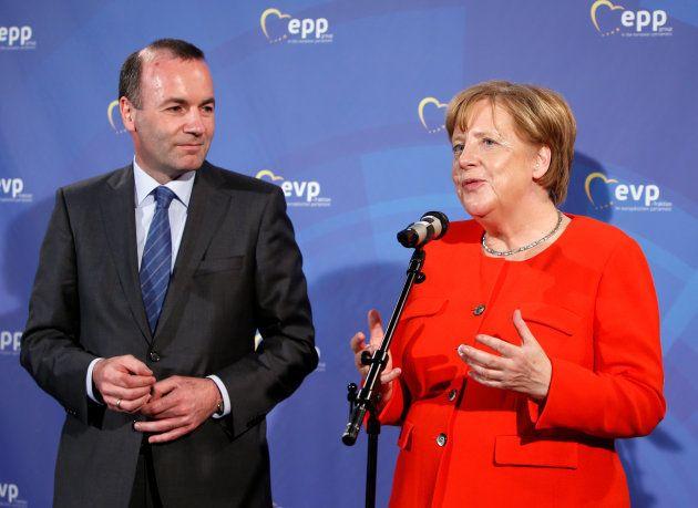 La canciller alemana Angela Merkel y Manfred