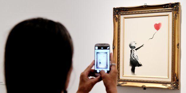 Banksy muestra cómo gestó la destrucción de su obra subastada