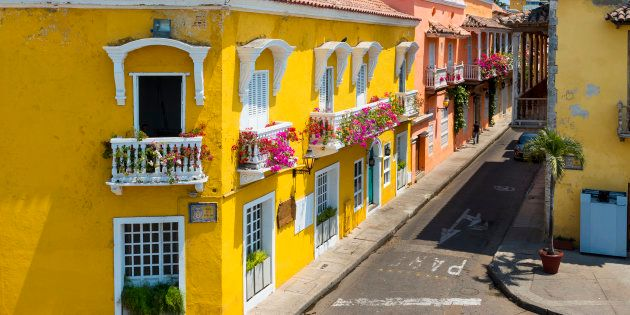 Colorful buildings in a street of the old city of Cartagena (Cartagena de Indias) in Colombia, South