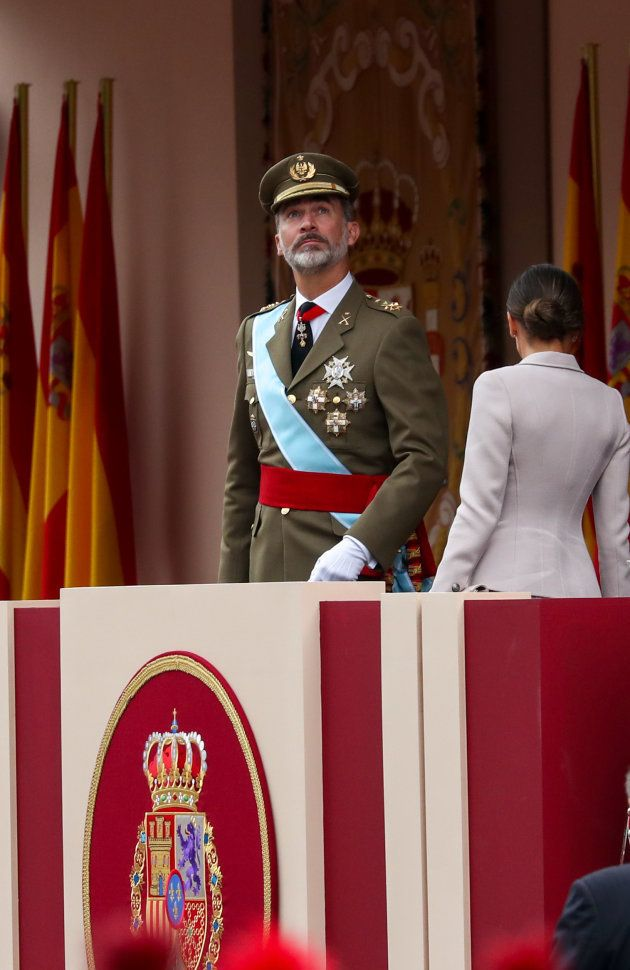 Spain's King Felipe stands next to Queen Letizia as they arrive to attend a parade as part of celebrations...