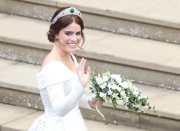 Britain's Princess Eugenie of York waves as she arrives for her wedding to Jack Brooksbank at St George's...