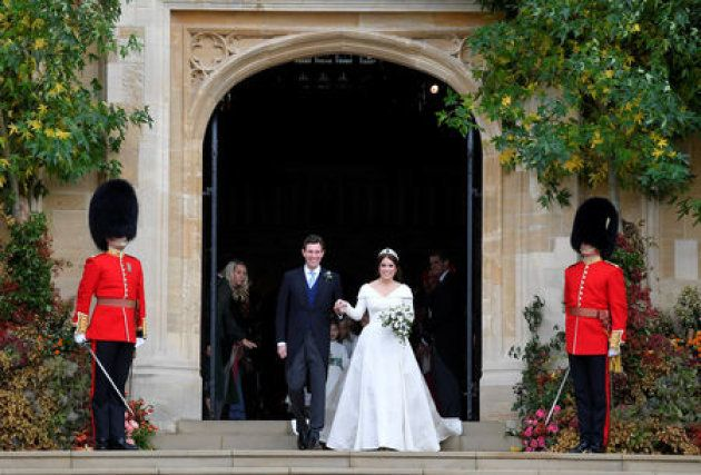 Britain's Princess Eugenie of York and her husband Jack Brooksbank leave after their wedding at St George's...