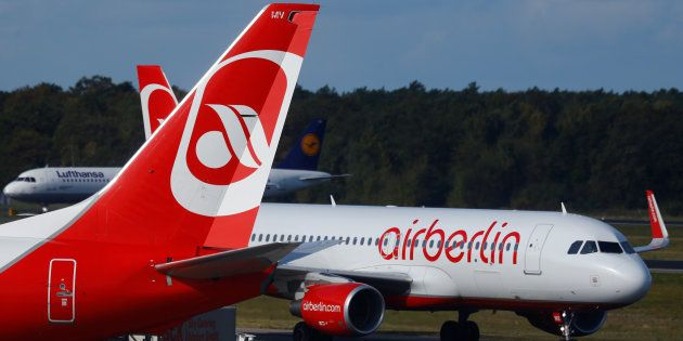 A Lufthansa airliner taxis next to the Air Berlin aircraft at Tegel airport in Berlin, Germany, October...