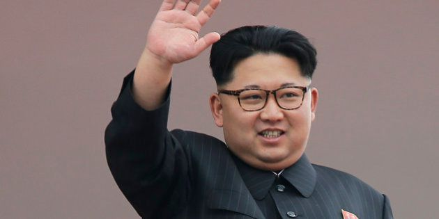 North Korean leader Kim Jong Un waves at parade participants at the Kim Il Sung Square on Tuesday, May...