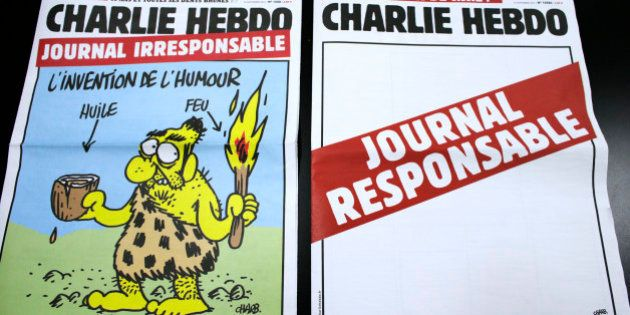 A picture taken on September 25, 2012 in Paris shows today's two editions of French satirical magazine...