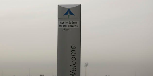 The logo of Spanish airports operator Aena is seen on the top of a welcoming sign outside Adolfo Suarez...