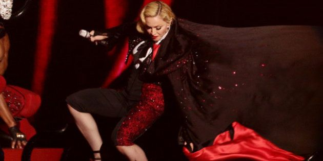 Madonna takes a stumble down stairs whilst performing on stage, during the 2015 Brit Awards at the O2...
