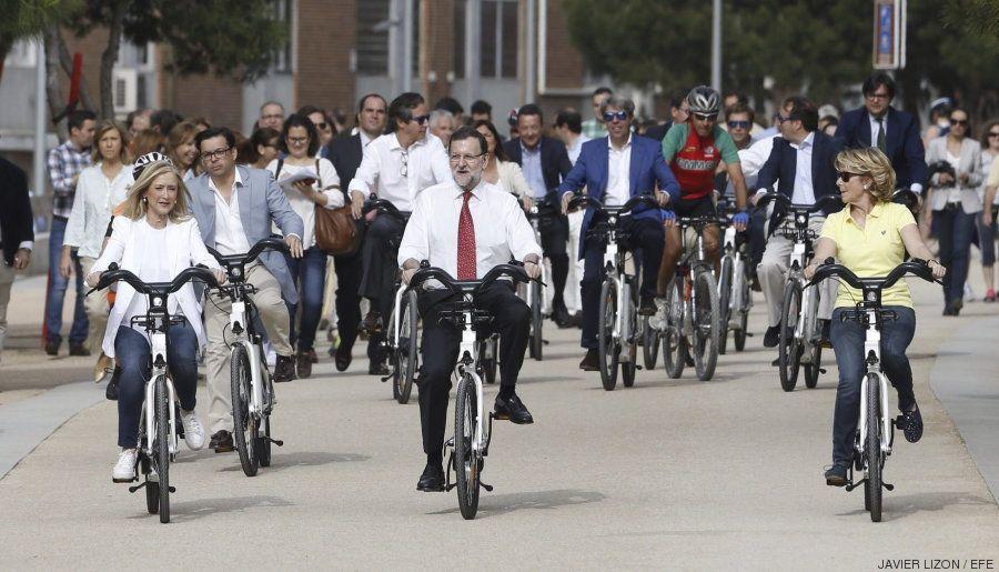 Rajoy en bici con Aguirre y Cifuentes para hacer campaña en