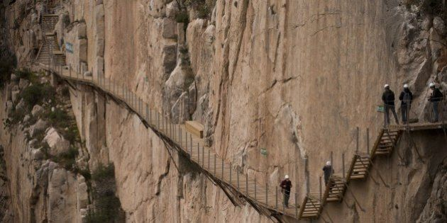 Journalists walk during a visit to the foot-path 'El Caminito del Rey' (King's little path) a narrow...