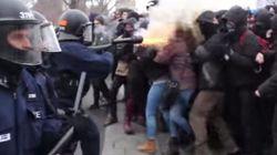 Un policía de Quebec dispara un bote de gas a la cara de una