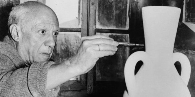 A photo taken on October 22, 1961 shows Spanish artist Pablo Picasso painting a potery at the Madoura...