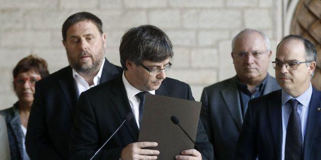 El president, Carles Puigdemon, junto a Oriol Junqueras y Jordi