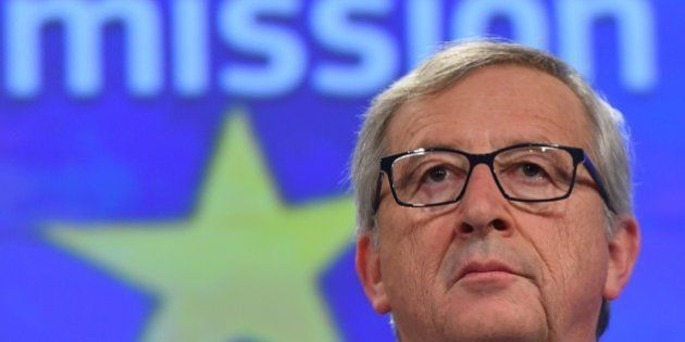 European Commission President Jean-Claude Juncker gives a press conference at the end of German chancellor's...