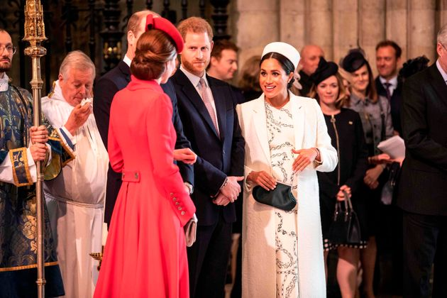 The Duchess of Cambridge (foreground) and Duchess of Sussex greet each other as they attend the Commonwealth...