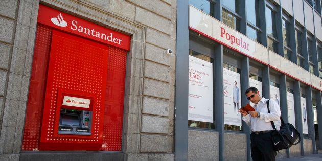 Santander permite a los clientes de Popular usar sus cajeros sin coste y empieza a integrar la