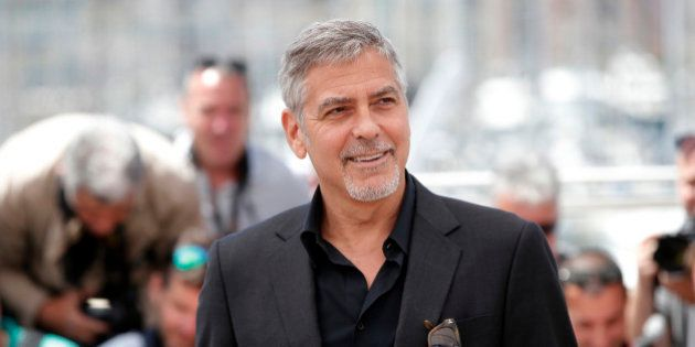 Actor George Clooney poses for photographers, during a photo call for the film Money Monster at the 69th...