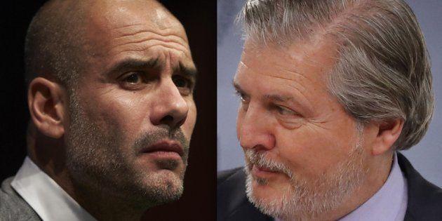 Pep Guardiola, actual entrenador del Manchester City, y el ministro portavoz Íñigo Méndez de Vigo, en...