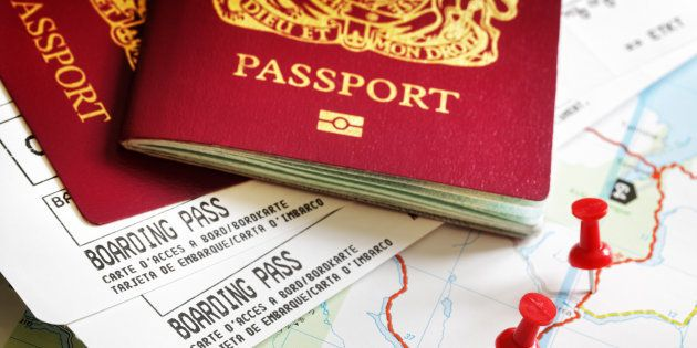 Boarding pass and passport on map with thumbtack concept for travel and