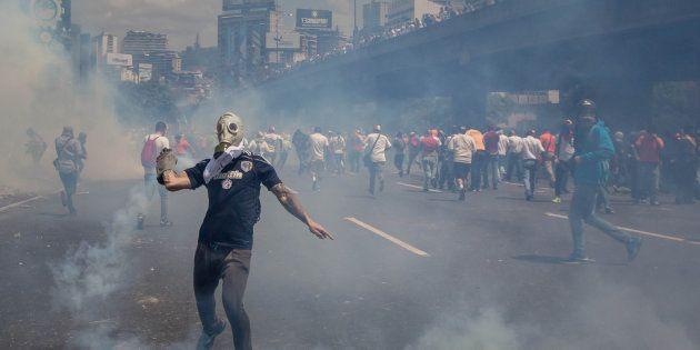 Un grupo de personas participan en una manifestación contra el gobierno