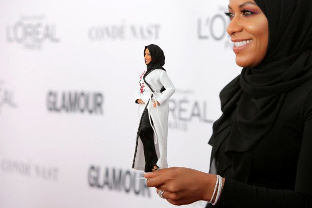 Olympic fencer Ibtihaj Muhammad holds a Barbie doll made in her likeness as she attends the 2017 Glamour...