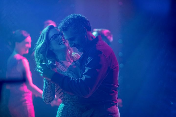 "Moore and John Turturro in ""Gloria Bell."""