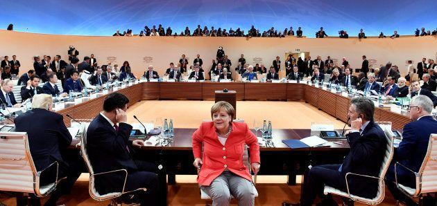 Angela Merkel, la canciller alemana, entre el norteamericano Donald Trump, el chino Xi Jinping -de un...