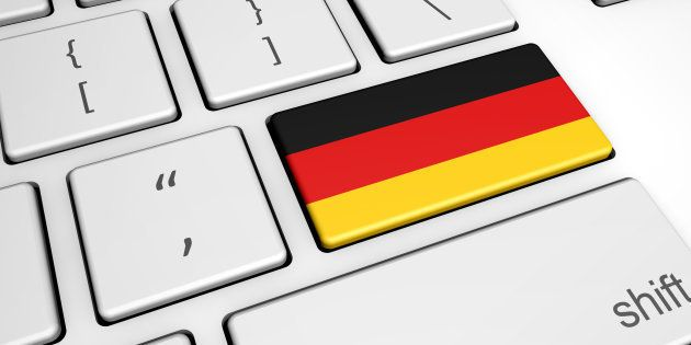 Digitalization and use of digital technologies in Germany with the German flag on a computer