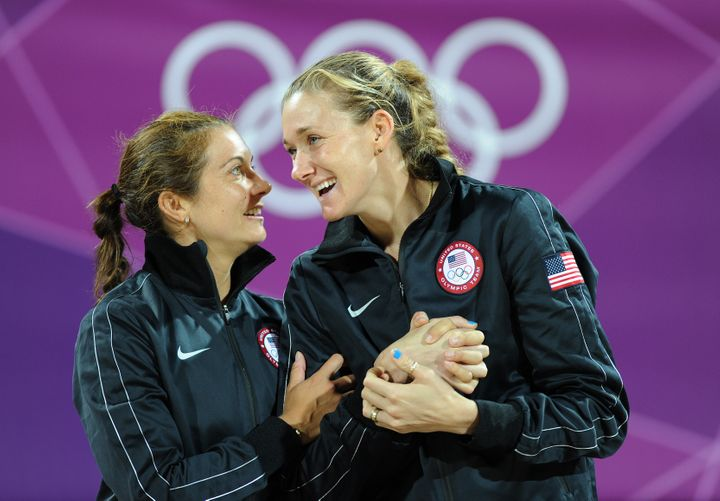 The book holds gold medallists Misty May-Treanor and Kerri Walsh Jennings as great examples of work wives. Here, the pair celebrate on the podium during the medal ceremony for the women's beach volleyball at the London 2012 Olympic Games.