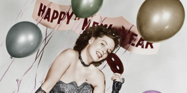 Young woman sitting on a table with balloons and