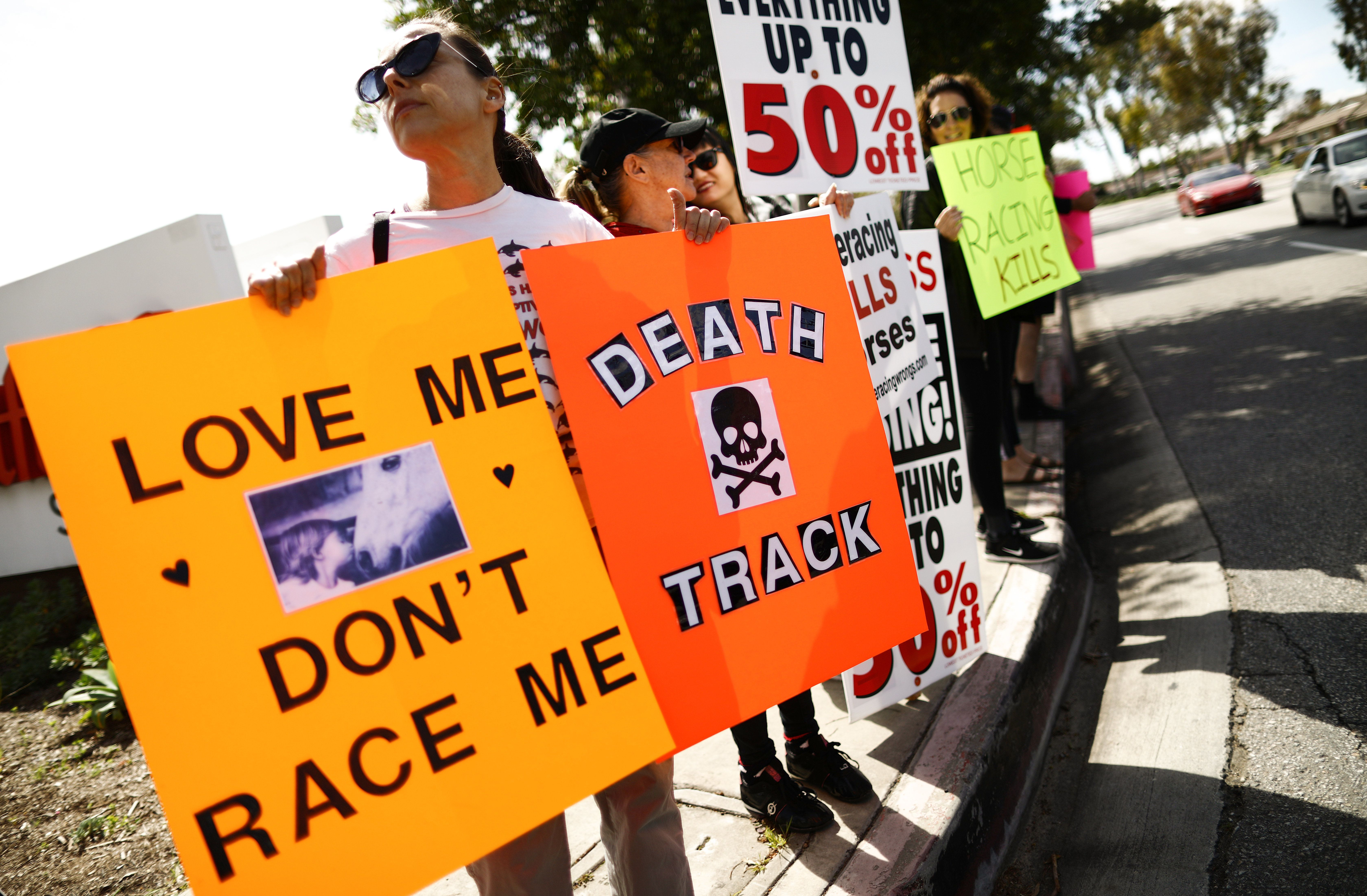 ARCADIA, CALIFORNIA - MARCH 10:  Animal rights activists protest horse racing deaths outside Santa Anita Park on March 10, 2019 in Arcadia, California. Santa Anita has suspended horse racing after 21 horses died at the famed racetrack since December 26. The track is reportedly eyeing a March 22nd date to re-start races as an investigation into the cause of the deaths continues. (Photo by Mario Tama/Getty Images)