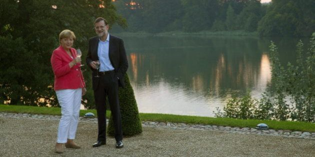 Rajoy y Merkel, de paseo por el lago de Huwenow