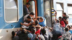 Hungría desbloquea la estación de trenes y los refugiados tratan de huir a la