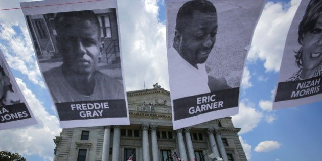Pictures of Eric Garner, Freddie Gray and Nizah Morris are seen while people take part in the Million...