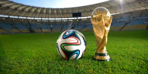 RIO DE JANEIRO, BRAZIL - DECEMBER 03: A general view of Brazuca and the FIFA World Cup Trophy at the...