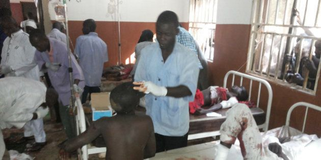 People are treated at the General hospital in Potiskum, Nigeria, Monday, Nov. 10, 2014, following a suicide...