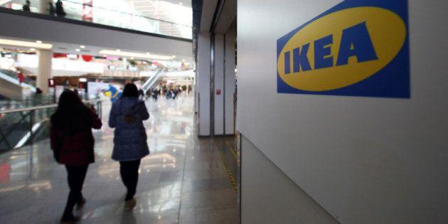 Customers walk past an Ikea logo at the Ikea Beijing Xihongmen Store, operated by Ikea AB, in Beijing,...