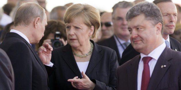 Putin y Poroshenko, el presidente electo de Ucrania, se reunen y piden el fin del