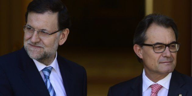 Spanish Prime Minister Mariano Rajoy (L) and president of Catalonia's regional government Artur Mas pose...