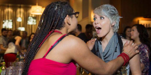 Surprised woman talking to friend in
