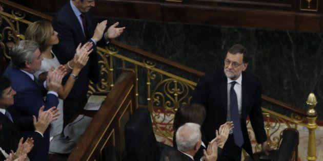 Rajoy, reelegido presidente gracias a la abstención de un resquebrajado