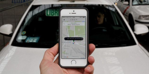 MADRID, SPAIN - OCTOBER 14: In this photo illustration the new smart phone taxi app 'Uber' shows how...