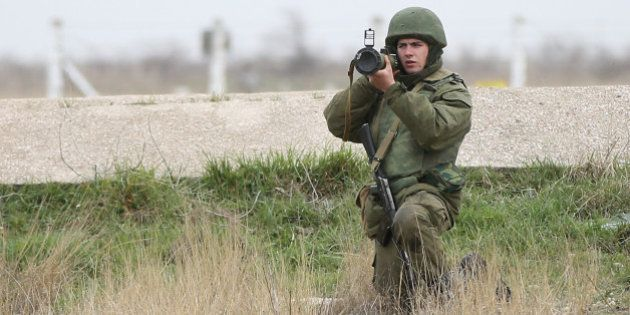 LUBIMOVKA, UKRAINE - MARCH 04: A soldier under Russian command aims a rocket propelled grenade launcher...