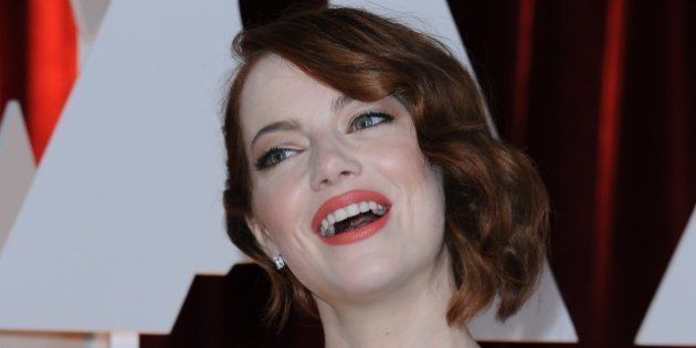 Nominee for Best Supporting Actress Emma Stone arrives on the red carpet for the 87th Oscars on February...