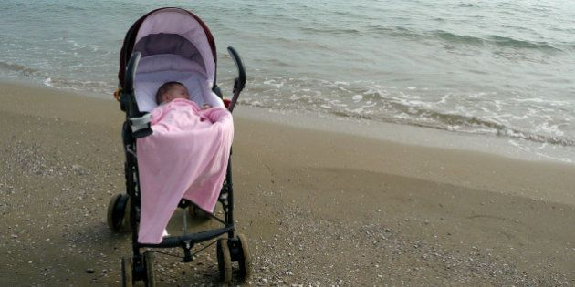 Baby girl in pram on solitary